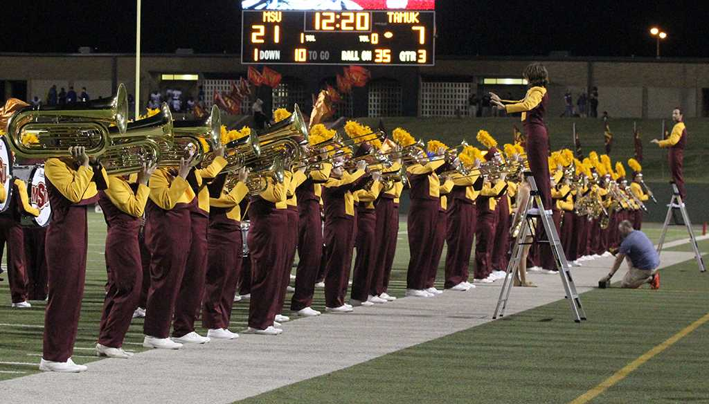 The Golden Thunder Marching Band preforms in the half time show during the game against Texas A&M Kingsville at Memorial Stadium Sept. 16. Photo by Rachel Johnson