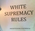 """This """"White Supremacy Rules"""" poster was posted on a car on campus along with 3 other posters similar to it with different hashtags. The other three hashtags included: #FUCKCAMPUSCLIMATE, #WHITEPOWER, and #ONOURCAMPUS with the same """"White Supremacy Rules"""" at the top of all of them. Photo by Francisco Martinez"""