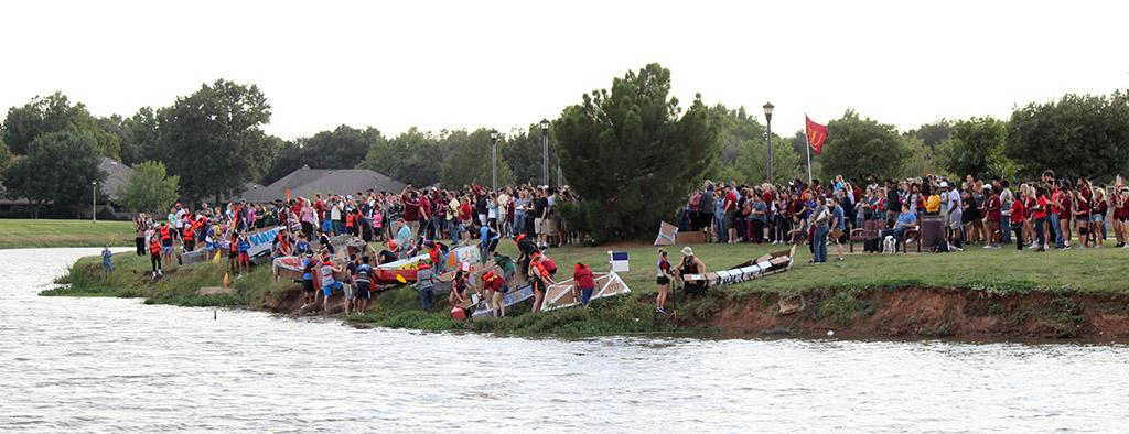 Students line their boats up along the edge of the water of Sikes Lake for the 2017 Homecoming Boat Race, Friday Oct. 20, 2017. Photo by Rachel Johnson