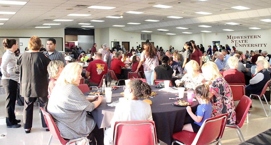 People sit down to enjoy their food at the Homecoming Fish Fry at Sikes Center, Friday OCt. 20, 2017. Photo by Rachel Johnson