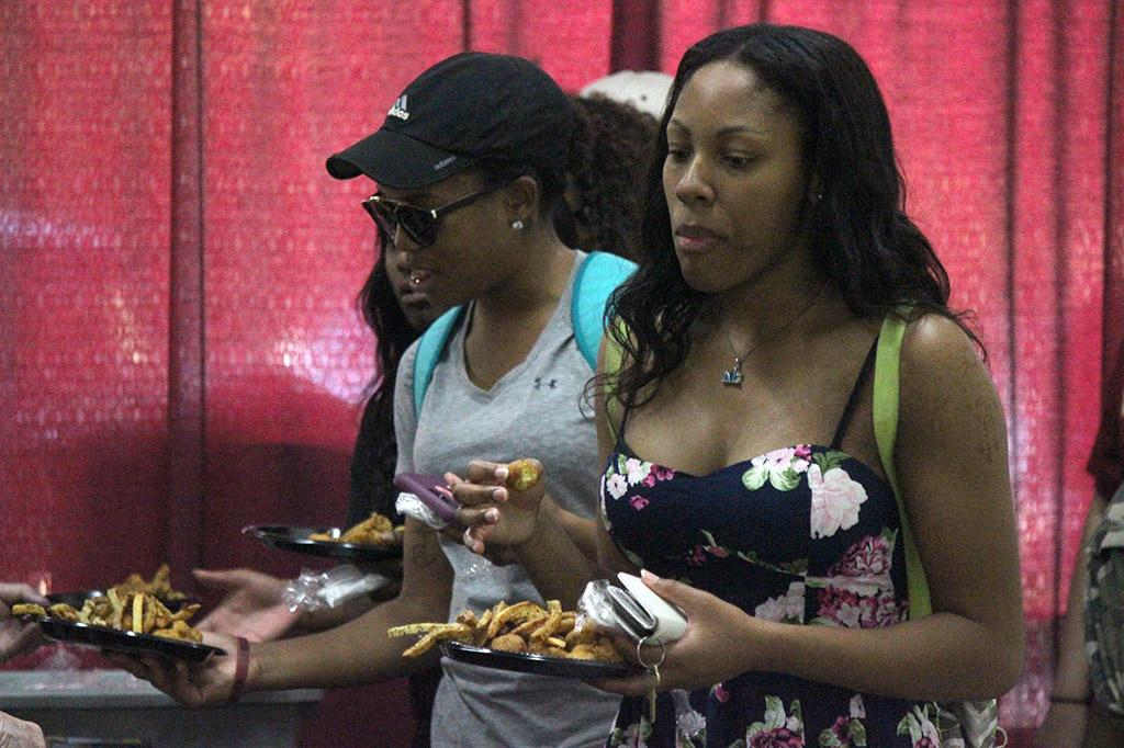 Cierra Scott, general business sophomore, gets food in the line at the Fish Fry at Sikes Center, Friday Oct. 20, 2017. Photo by Rachel Johnson
