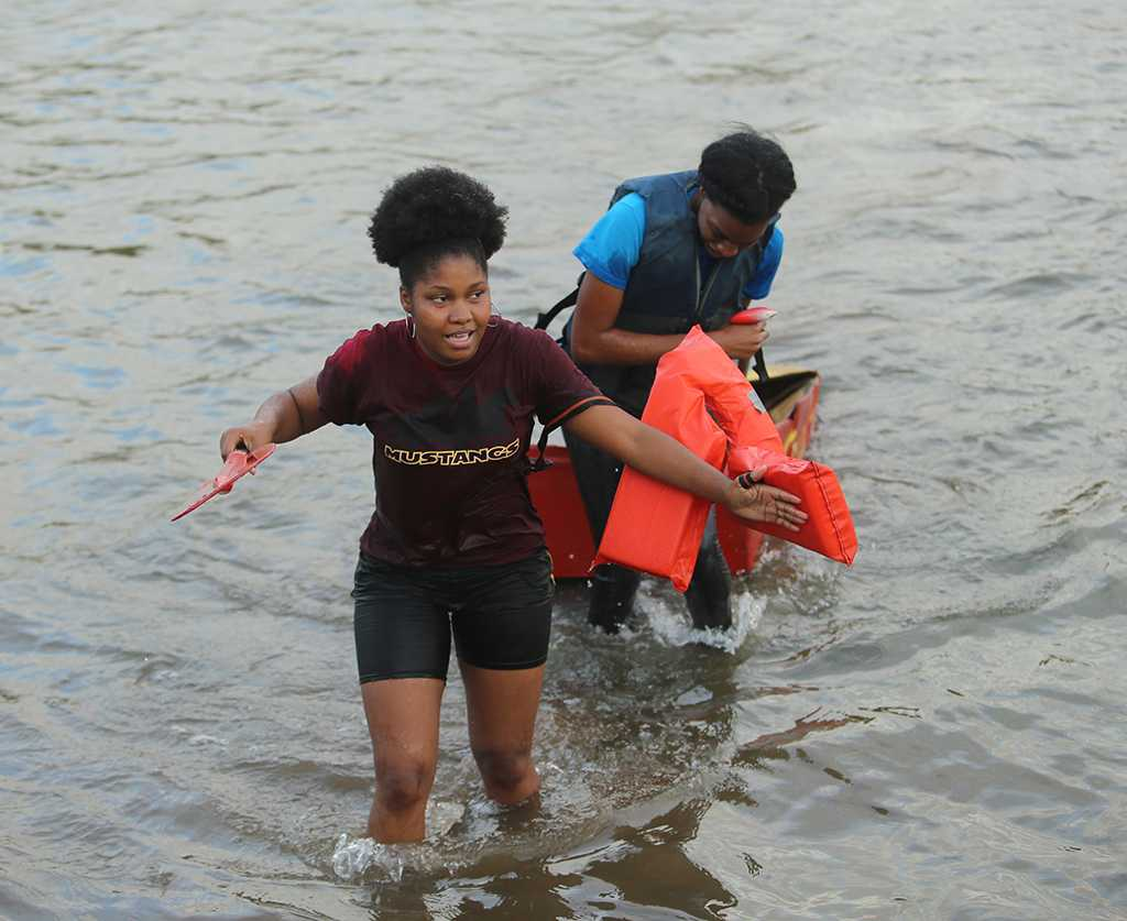 Tarrah Miller, biology senior, at the homecoming cardboard boat race on Sikes Lake Oct. 20, 2017. Photo by Bradley Wilson
