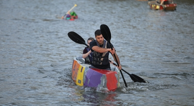 in the ASME boat, Clayton Masters, engineering junior, and Kyndall Diehm, engineering sophomore, placed first at the homecoming cardboard boat race on Sikes Lake Oct. 20, 2017. Photo by Bradley Wilson