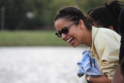 Kaylor Winter-Roach, theater senior, laughs as the Alpha Psi Omega, the theater fraternity, boat sinks with her friends in it during the Homecoming Boat Race, Friday, Oct. 20, 2017. Photo by Rachel Johnson