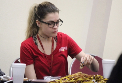 Brittni Vilandre, marketing sophomore, eats her food at Sikes Center during the Homecoming Fish Fry, Fri. OCt. 21, 2017. Photo by Rachel Johnson