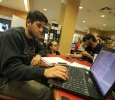 Rigo Guerrero, biology freshman, studies in the Books-A-Million at the mall after a bomb threat forced the evacuation of the campus Dec. 8. Photo by Lauren Roberts