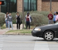 Students wait to cross the street after a bomb threat forced the evacuation of the campus Dec. 8. Photo by Lauren Roberts