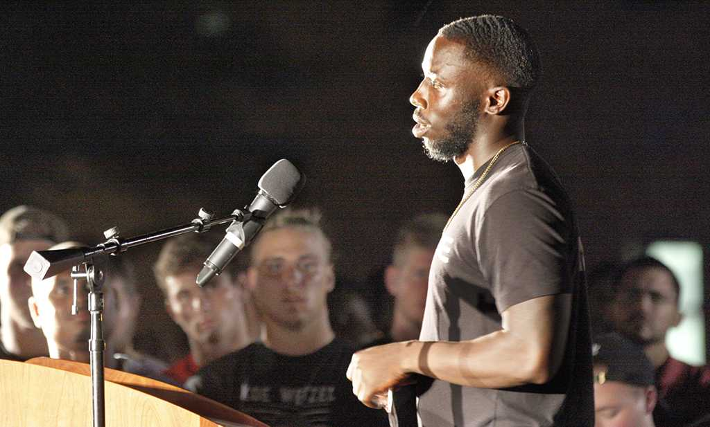 Sir'vell Ford, criminal justice junior and safety, speaks at the candle light vigil in honor of Robert Grays, , on the Jesse Rogers Promenade on Sept. 21.  Photo by Justin Marquart