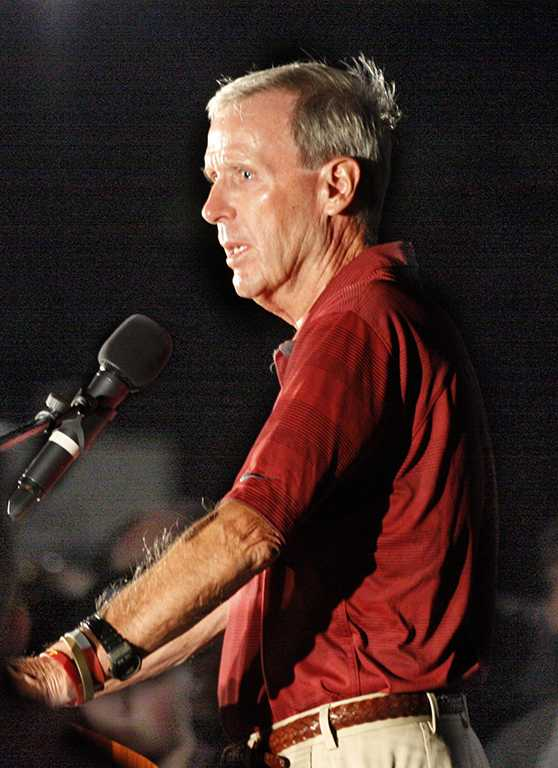 Bill Maskill, head football coach, speaks at the candle light vigil in honor of Robert Grays, , on the Jesse Rogers Promenade on Sept. 21.  Photo by Justin Marquart
