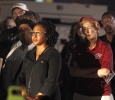A.J. Lopez, social media coordinator, Syreeta Greene, director of equity, inclusion and multicultural affairs, and Suzanne Shipley, university president, at the candle light vigil in honor of Robert Grays, , on the Jesse Rogers Promenade on Sept. 21. Photo by Justin Marquart