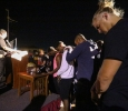 Khalil Finley, freshman mass communication, Stephen butler, junior & safety, at the candlelight vigil remembering Robert Greys on the Jesse Rogers Promenade on Sept. 21. Photo by Elias Maki