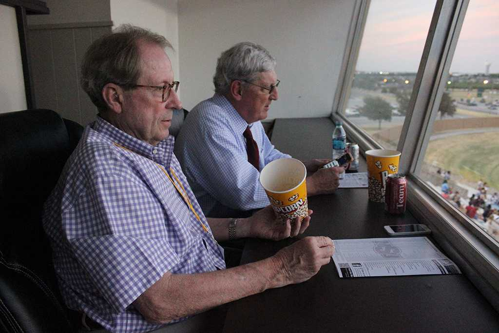 Now retired University President Jesse Rogers hangs out with Charlie Carr, athletic director, in the press box at Memorial Stadium during the opening game of the season, Sept 5. Rogers goes on to talk about his most recent fishing trip since being retired. Also how good the band was sounding tonight and how much bigger the student section has gotten. Midwestern State beat Truman State University 31-3. Photo by Rachel Johnson