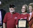 Athletic Director Charlie Carr and University President Suzanne Shipley present Gary and Becky Morrison with Midwestern State University Annual Letterman's Award at the Homecoming football game. 29th Oct. Photo by Bridget Reilly