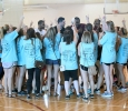 Chi-Omegas surround the winning team, Fab 5, after the championship game and do their sorority chant around them. The Fab 5 beat Sticky Bandits 27-20 in the Chi-Omega Basketball Tournament, Swishes for Wishes, Saturday, March 28, 2015. Photo by Rachel Johnson