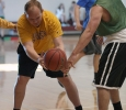 Dennis Roeder, finance senior, reaches out to grab the ball, after dropping it, as Coleman James, undecided sophomore, goes for the ball as well during the Chi-Omega Basketball Tournament, Swishes for Wishes, Sat. March 28, 2015. Photo by Rachel Johnson