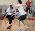 "Andre Shaw, grad assistant coach, dribbles past Zach Davis, history sophomore, who tries to block him, during the Chi-Omega Basketball Tournament, Swishes for Wishes. Fab 5 beat Sticky Bandit, 27-20, in the championship game, Saturday, March 28, 2015. Shaw said, ""We did it to give back, bring back unity to the school, and help a good cause."" Photo by Francisco Martinez"
