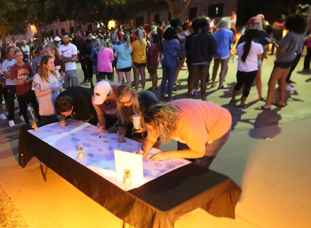 Students wait to sign the poster for injured football player. Photo by Elias Maki.