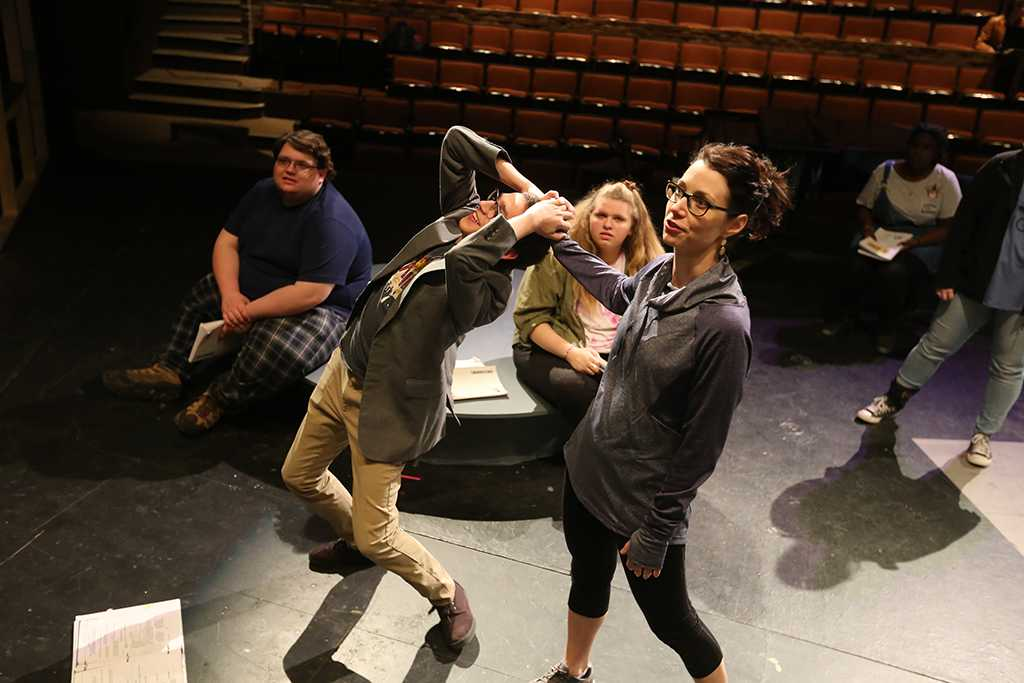 """Christie Maturo demonstrates how to pull hair in a fight with Chris Cruz at """"Urinetown"""" rehearsal Jan. 31. Photo by Bradley Wilson"""