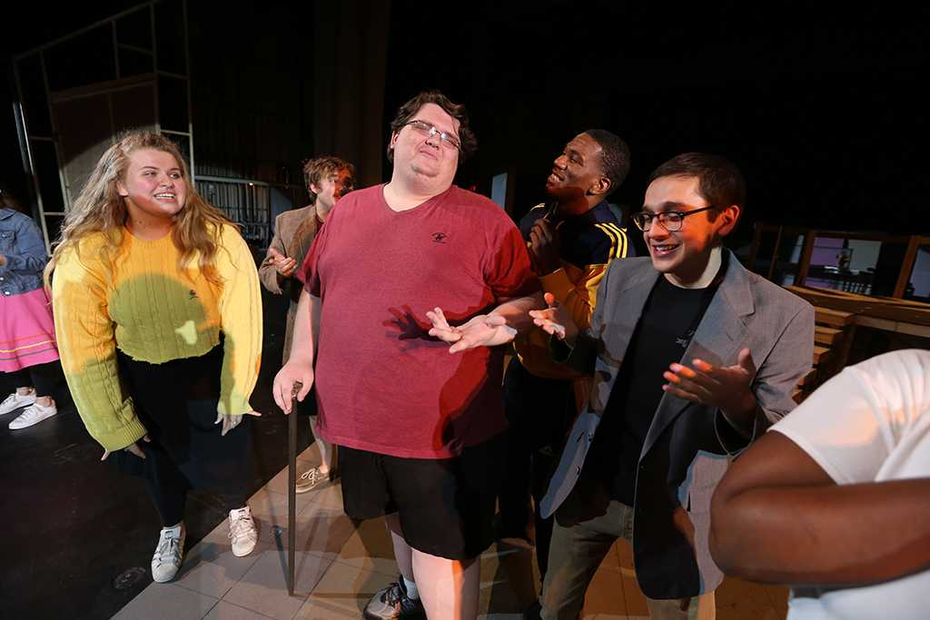 """Cast members, including Shannon Howerton in the role Caldwell B. Cladwell, practice """"Mr. Cladwell"""" at """"Urinetown"""" rehearsal Jan. 24. Photo by Bradley Wilson"""