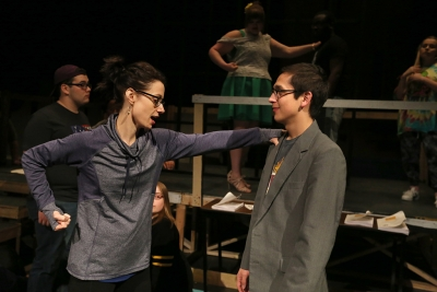 "Christie Maturo demonstrates how to throw a punch with Chris Cruz at ""Urinetown"" rehearsal Jan. 31. Photo by Bradley Wilson"
