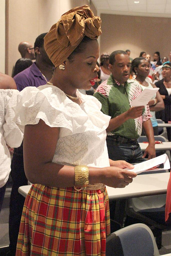 Alefia Paris-toulon, alumni, sings during worship at the Candlelight vigil put on by Carribean Student Organization in Bolin 100, Sept. 1. Photo by Rachel Johnson