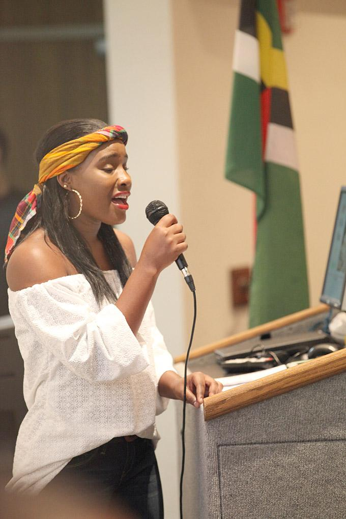 """Francine Baron, special education junior, sings, """"I Look to You,"""" in Bolin 100 to remember the victims of the remnants of tropical storm Erika Sept. 1. Photo by Francisco Martinez"""