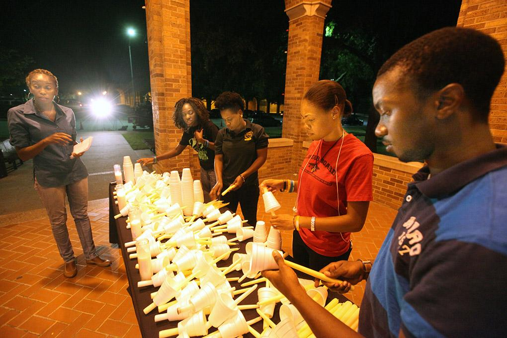 Members of the Caribbean Student Organization prepare candles outside of Bolin Hall Sept. 1. Photo by Francisco Martinez