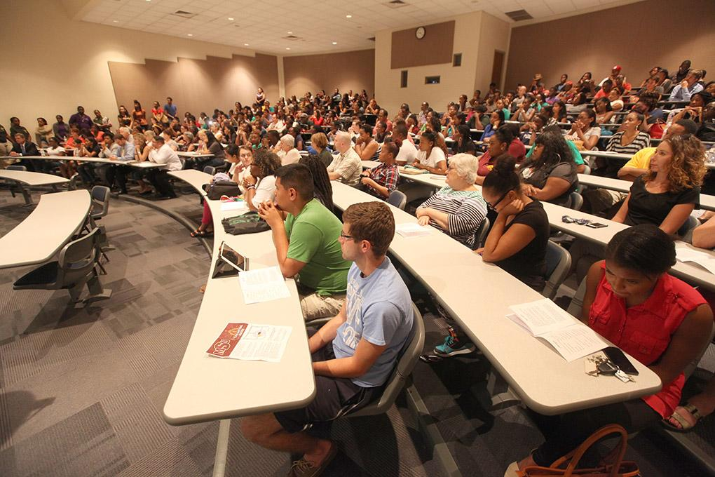 Students and others gather in Bolin 100 to honor the victims of the remnants of tropical storm Erika at the Caribbean Student Organization Candlelight Vigil, Sept. 1. Photo by Francisco Martinez