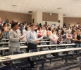 Students and others gather in Bolin 100 to send songs and prayers to the island of Dominica, ending the ceremony with a candle light vigil in honor of the people of Dominica. Photo by Rachel Johnson