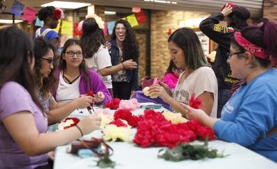 MSU students and guest participate making flower headbands during the Dia de los Muertos event held by multiple organizations in the Atrium, Wednesday, Nov. 1, 2017. Photo by Francisco Martinez