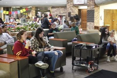 MSU students and guest sit down watching The Book of Life movie during the Dia de los Muertos event held by multiple organizations in the Atrium, Wednesday, Nov. 1, 2017. Photo by Francisco Martinez