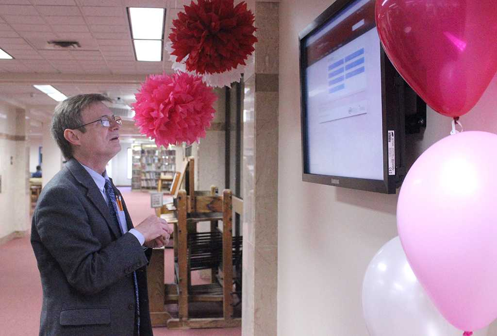 Peter Fields, english associate professor, tries out the new MSU History Display in the second floor of Moffett Library, during the unveiling of the display, Feb. 9. Photo by Rachel Johnson
