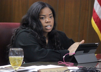 Shayla Owens, student regent, gives the student voice to the alterations and told University President Suzanne Shipley that she thought that the alterations wouldn't take away from waht the students would be expecting to see when the building is done, during the emergency board meeting, Wed. Dec. 13, 2017. Photo by Rachel Johnson