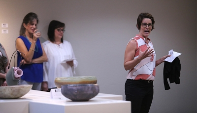 Kelly O'Briant, assistant professor of ceramics at the University of Dallas, announces the award-winning entries at the opening for Empty Bowls of Wichita Falls at the Wichita Falls Museum of Art. Photo by Bradley Wilson