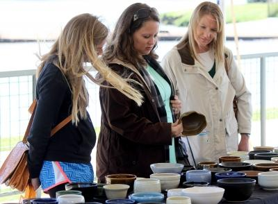 Erika Collborn, attendee, Tara McKnight, attendee, and Ginger Cross, attendee view student made bowls during the Empty Bowls of Wichita Falls at Wichita Falls Museum of Art at MSU, Oct 10, 2017. Photo by Francisco Martinez