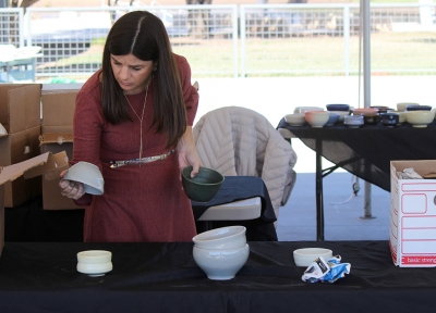 Tanya Gillen, 2nd vice chair for Wichita Falls food bank, sorts through the student made bowl during the Empty Bowls of Wichita Falls at Wichita Falls Museum of Art at MSU, Oct 10, 2017. Photo by Francisco Martinez