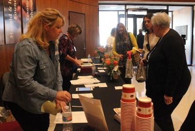 Attendees check-out at the front desk during the Empty Bowls of Wichita Falls at Wichita Falls Museum of Art at MSU, Oct. 10, 2017. Photo by Francisco Martinez
