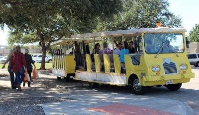 Attendees of the Empty Bowls Event get on the trolly after visiting the Wichita Falls Museum of Art at MSU to take them back to their parked cars, Oct. 10. Photo by Francisco Martinez