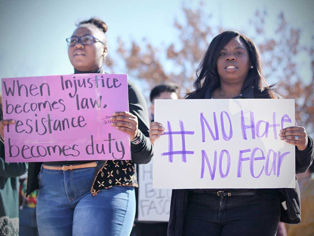 Ricinda Turner, mass communications junior, and Shayla Owens, management senior, and SGA president at the rally against the immigration executive order, on Feb. 1st. Photo by Bridget Reilly