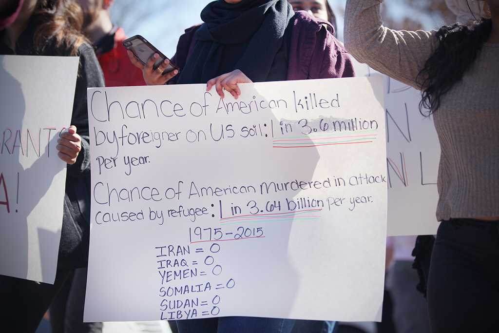 Statistics written on a poster by a student involved in the rally against the immigration executive order, on Feb. 1st. Photo by Bridget Reilly