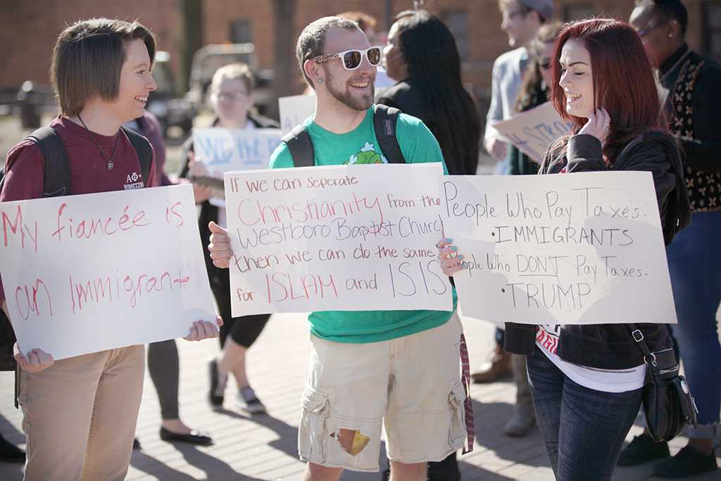 Kristy Henderson, English sophomore, Kalli Root, english senior, and Logan Yates, psychology senior, at the rally against the immigration executive order, on Feb. 1. Photo by Bridget Reilly