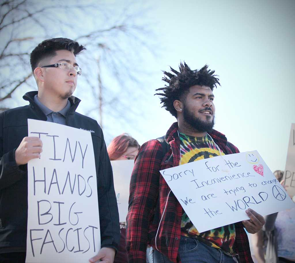 Elias Moncivais, athletic training sophomore, and Harrison Elizardo, sociology sophomore, at the rally against the immigration executive order, on Feb. 1st. Photo by Bridget Reilly