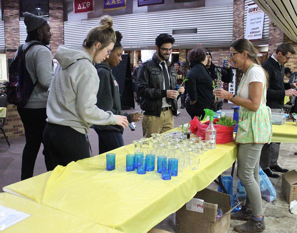Students line up to make their own Lucky Bamboo as a part of Finals Frenzy in the Clark Student Center Atrium Thursday, Dec. 7, 2017. Photo by Rachel Johnson