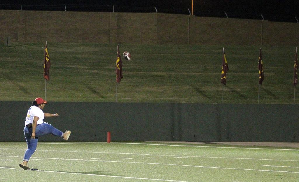 Maurisha Peyton, early childhood education junior, gets to kick a field goal for a prize during the Mustangs vs Western New Mexico football game held in the Wichita Falls Memorial Stadium. Sept. 30. Photo by Marissa Daley