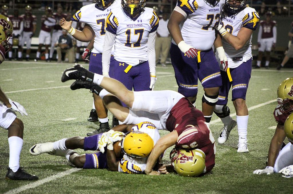 Zach McMahen, criminal justice sophmore, tackles a New Mexico football player during the Mustangs vs Western New Mexico football game held in the Wichita Falls Memorial Stadium. Sept. 30. Photo by Marissa Daley
