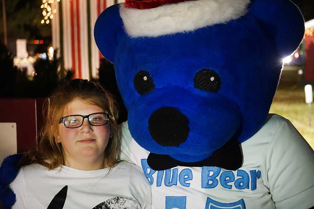 Abigail Riley a Bradford elementary student hugs the blue bear at fantasy of lights. Photo by Topher McGehee