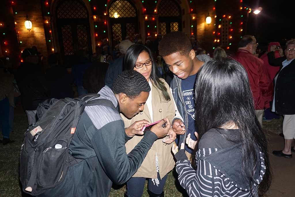 Preston Busby criminal justice sophomore, Baylee Wichlan music education junior, Xavier Alexander vocal performance sophomore and Lilliana Lopes respitory junior discuss the fantasy of lights. Photo by Topher McGehee