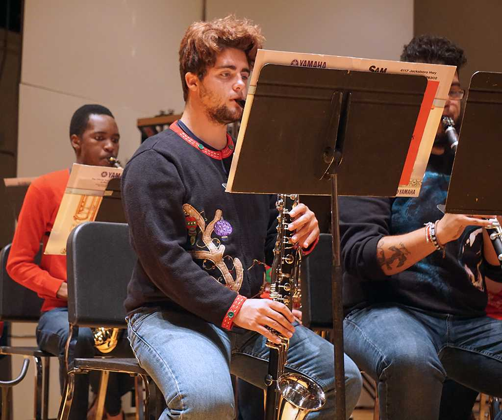 Joshua Poling plays bass clarinet in the University Wind Ensemble Fantasy of Lights concert. Photo by Topher McGehee