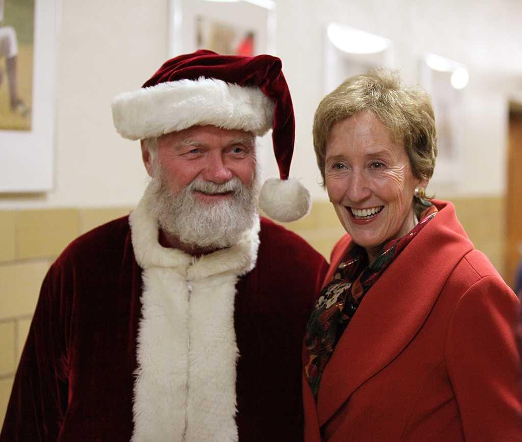"Woodrow ""Woody"" Gossom, Jr., Wichita Falls county judge, and Suzanne Shipley, university president, pose for photos before Fantasy of Lights opening ceremony on Nov. 21. Gossom, Jr. plays Santa Claus. Photo by Kara McIntyre"
