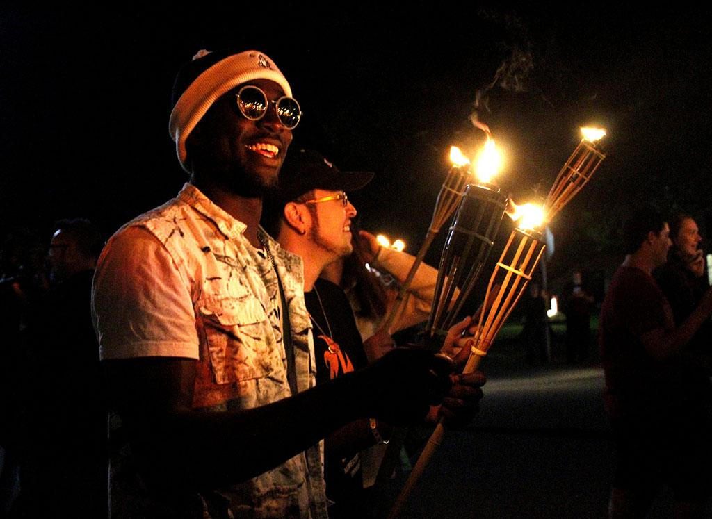 Anthony Onwuegbuchu, mechinical enginering junior , at the homecoming torch light parade, Thurday , Oct 19,2017. Photo by Sara Keeling